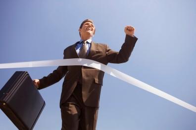 Businessman Crossing the Finish Line
